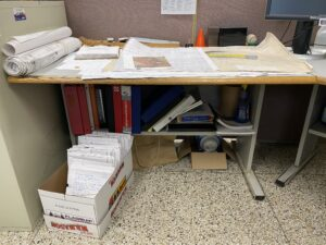a before photo of a workplace table, before there was joy at work with KonMari