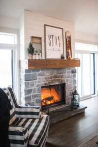 Fall KonMari Challenge Sage of Interiors Christine Thorn living room with fireplace and autumn fire